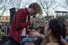 Lead singer of COIN, Chase Lawrence, during their energetic performance at Terpstock at the Nyumburu Amphitheater. (Cassie Osvatics/Bloc Reporter)