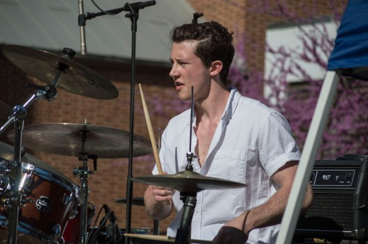 Drummer for Rent Party, Jack Kessler, during their performance at Terpstock at the Nyumburu Amphitheater. (Cassie Osvatics/Bloc Reporter)