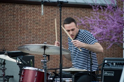 Drummer of COIN, Ryan Winnen, during their energetic performance at Terpstock at the Nyumburu Amphitheater. (Cassie Osvatics/Bloc Reporter)
