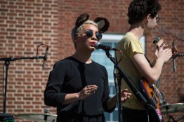 Singer Ash Escobar (left) and bassist Mikey Ambrosino (right) perform with Elie Rizk at Terpstock at the Nyumburu Amphitheater. (Cassie Osvatics/Bloc Reporter). (Cassie Osvatics/Bloc Reporter)