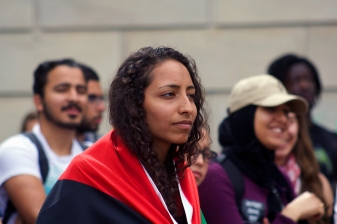 Laila Abujuma, a sophomore biology major, attended the teach-in in a Palestinian flag. (Julia Lerner/Photography Editor)