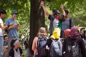 Students gathered at 3 pm at the top of McKeldin Mall to listen to a teach-in hosted by Students for Justice in Palestine and the Muslim Political Alliance. Many were already prepared to boycott Israelfest, but others were there to learn more about the issue. (Julia Lerner/Photography Editor)