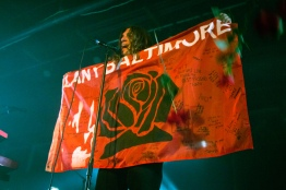 Paul Klein holds up a LANY Baltimore flag signed by fans during a performance at the Baltimore Soundstage on May 14, 2017. (Casey Tomchek/Freelance Photographer)