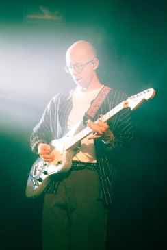 Les Priest of LANY plays the guitar during a performance at the Baltimore Soundstage on May 14, 2017. (Casey Tomchek/Freelance Photographer)