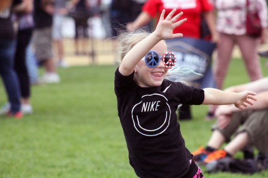 """A girl dances to the song """"Everybody Dance Now!"""" at the Mother of all Rallies. (Julia Lerner/Bloc Photographer)"""
