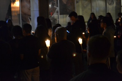 People support sexual assault survivors by holding up candles. (Lisa Woolfson/Bloc Photographer)