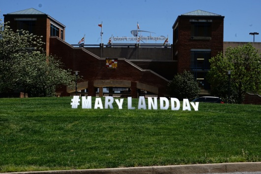A #MarylandDay sign by The Clarice Smith Performing Arts Center welcomes guests onto campus. (Taneen Momeni/Bloc Reporter)
