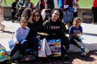 Tania Otero Martinez and her family sit on the sundial while eating a funnel cake. (Taneen Momeni/Bloc Reporter)